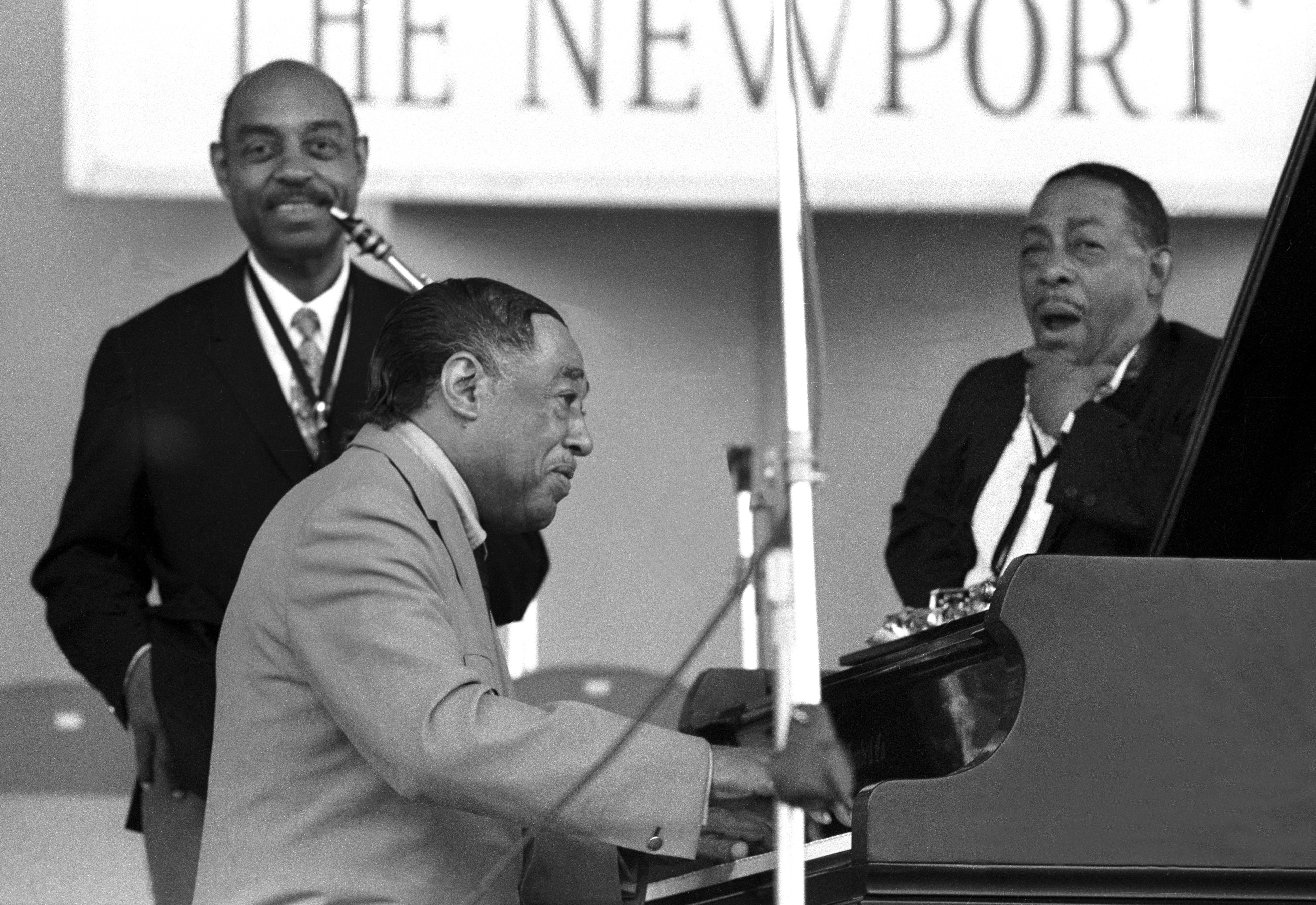 Johnny Hodges and Benny Carter perform with Duke Ellington and his orchestra onstage at the Newport Jazz Festival on July 6, 1968 in Newport, Rhode Island. (photo: Tom Copi/Michael Ochs Archives/Getty Images)