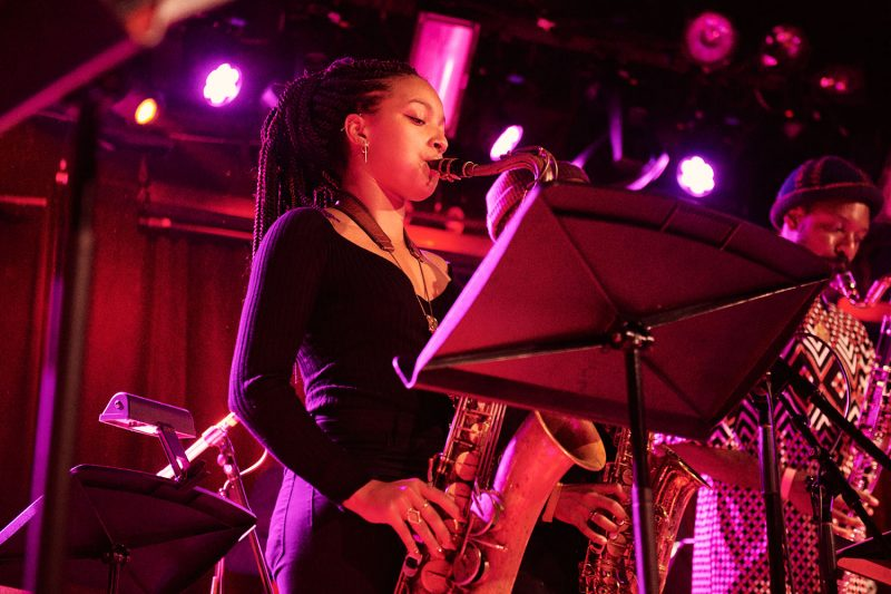 Nubya Garcia with Josh Johnson (obscured) and Shabaka Hutchings at Makaya McCraven's Universal Beings album release concert, (Le) Poisson Rouge, New York, December 2018 (photo: Vincent Tullo/Red Bull Content Pool)