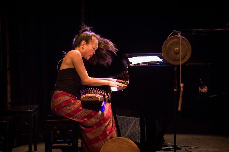 Jen Shyu playing piano. (Photo: Douglas Parsons)