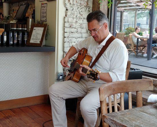 Guitarist John Merrill performing at Tartina in NYC (photo by Lee Mergner)