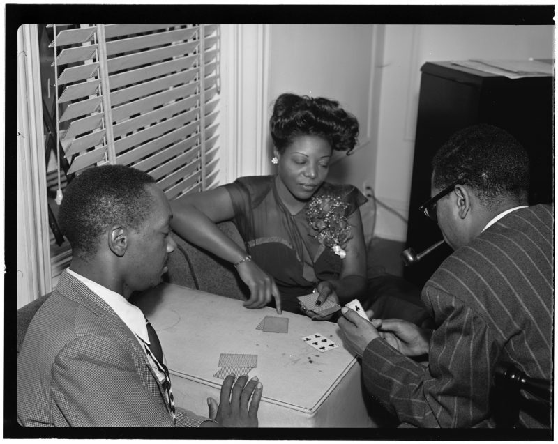 Mary Lou Williams playing cards at home with Tadd Dameron and Dizzy Gillespie, 1947