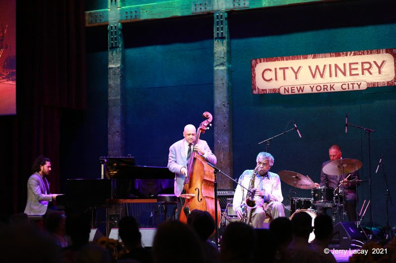 "Emmet Cohen, Peter Washington, George Coleman, and Joe Farnsworth at the Jazz Foundation's ""Spotlight Jazz"" event"